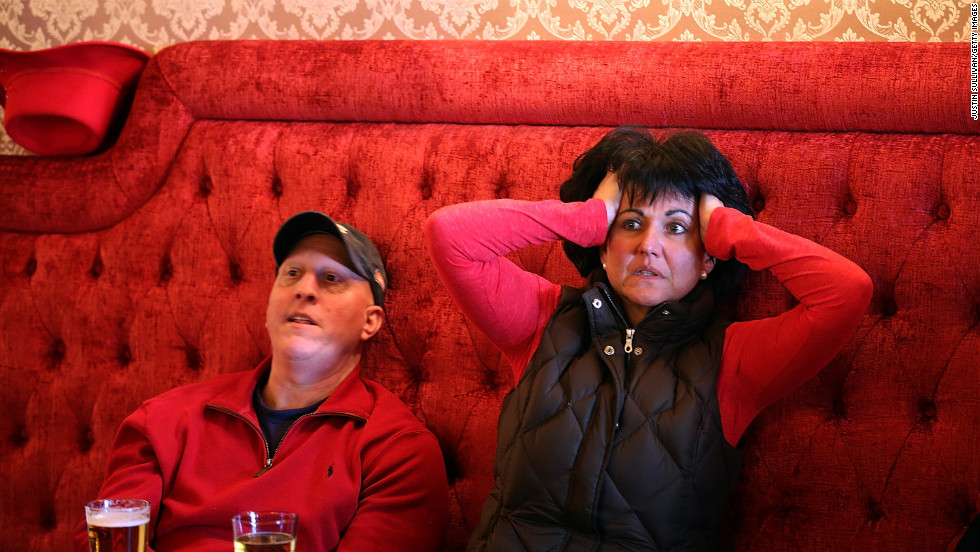 49er fans react as they watch Super Bowl XLVII at Gold Dust Lounge in San Francisco.