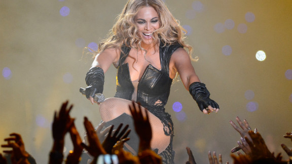 Beyonce reaches out to fans during her performance.