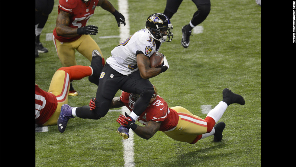 Patrick Willis of the San Francisco 49ers makes contact with Bernard Pierce of the Baltimore Ravens.
