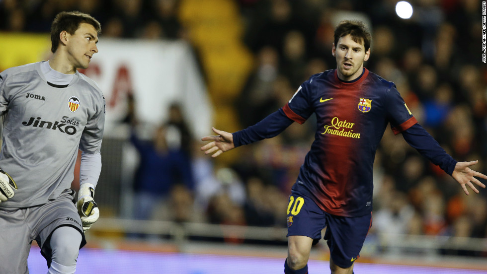 Barcelona forward Lionel Messi (right) celebrates after scoring from the penalty spot in the 1-1 draw against Valencia.