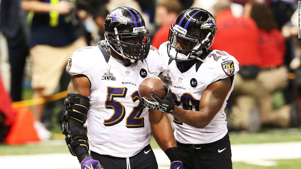 Ray Lewis, left, and Ed Reed of the Baltimore Ravens celebrate after the San Francisco 49ers couldn't convert on a fourth down play in the final two minutes of the fourth quarter.