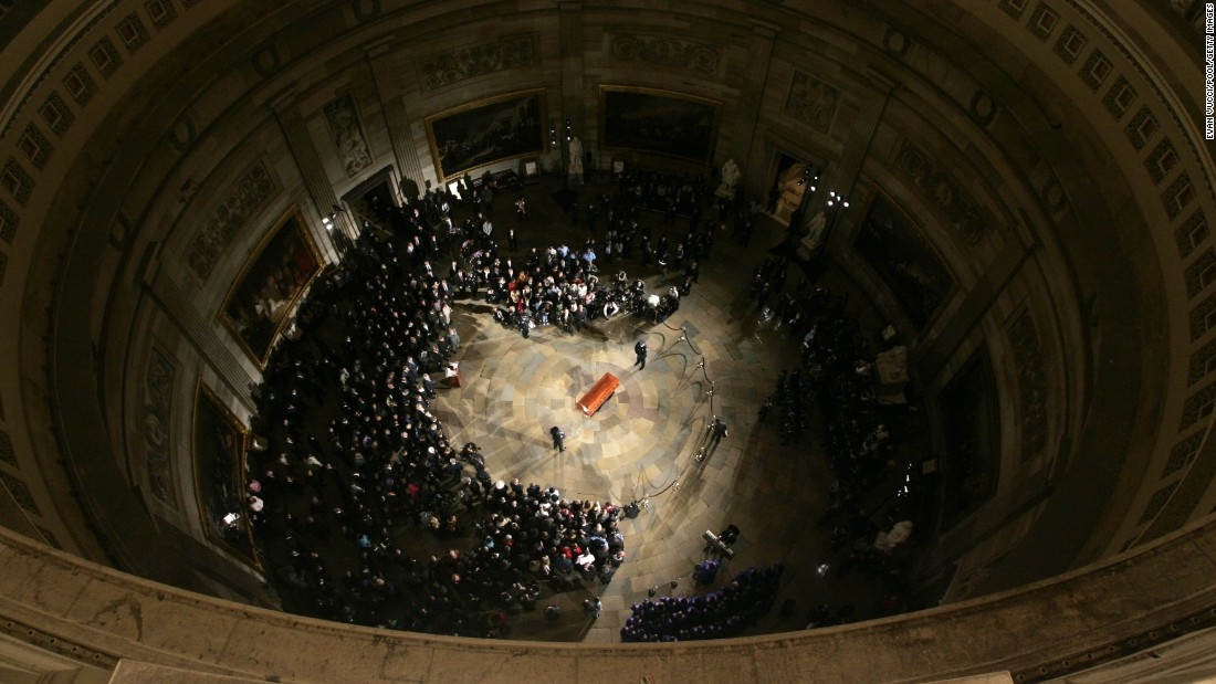 "Parks' casket lies in honor at the U.S. Capitol in October 2005. She was the first woman and the second African-American <a href=""http://history.house.gov/Institution/Lie-In-State/Lie-In-State/"" target=""_blank"">to lie in honor in the Capitol Rotunda.</a>"