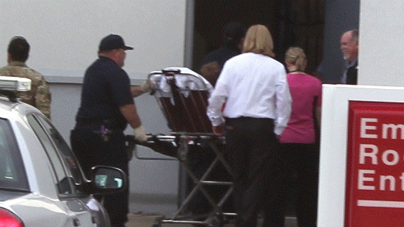 Ethan, the rescued boy, arrives on stretcher Monday at Flowers Hospital in Dothan, Alabama.