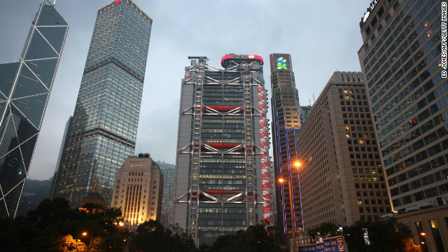 The HSBC hedquarters building (C) stands in Hong Kong on March 6, 2011. AFP PHOTO / ED JONES