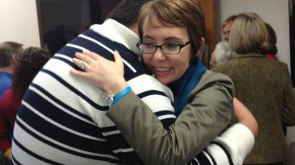Gabby Giffords hugs Daniel Hernandez Jr. on the first anniversary of the Tucson shooting