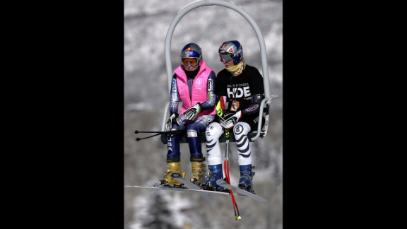 Kildow rides the lift with Maria Riesch of Germany during training for the FIS Alpine Skiing Women