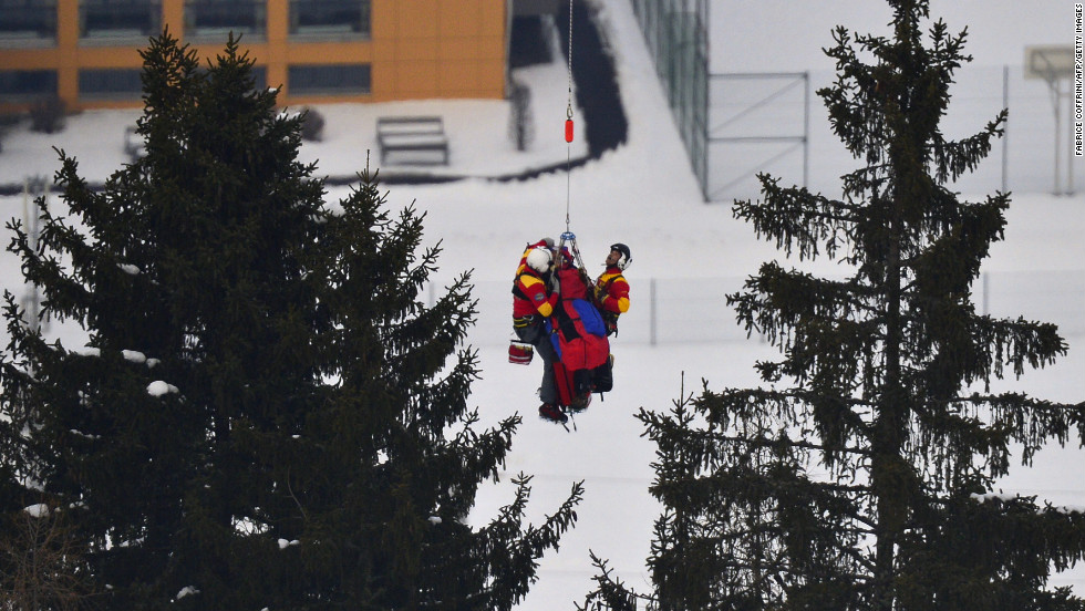 Vonn is lifted by a helicopter during the women's super-G event during the Alpine FIS Ski World Championships on Tuesday, February 5, 2013, in Schladming, Austria.