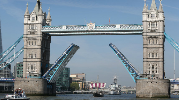 Tower Bridge opens its arms to the sailboat, which made a second journey last year from Sardinia to Britain. The voyage retraced the ancient Phoenician trading route with the Cornish.