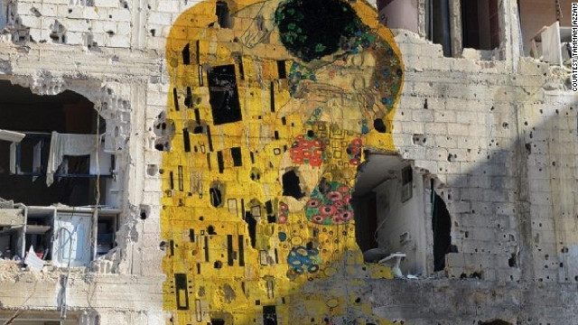"""Freedom Graffiti,"" by Syrian artist Tammam Azzam, features Klimt's ""The Kiss"" superimposed over a destroyed Syrian building."