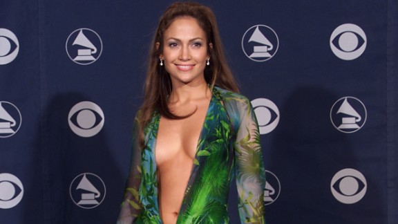 """The green Versace dress that Jennifer Lopez wore to the 2000 Grammy Awards might be her most iconic look to date. """"Those fashion moments happen by mistake -- you can't plan things like that,"""" Lopez has said of the risque ensemble. But daring looks like this may be a thing of the past if CBS gets its way this Sunday (February 10). Let's look back at the Grammys' most scandalous styles."""