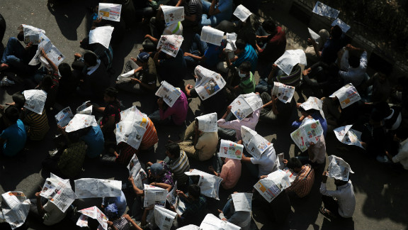 Bangladeshi social activists and bloggers in Dhaka use newspapers as hats during a demonstration demanding death sentences for war criminals on February 6.