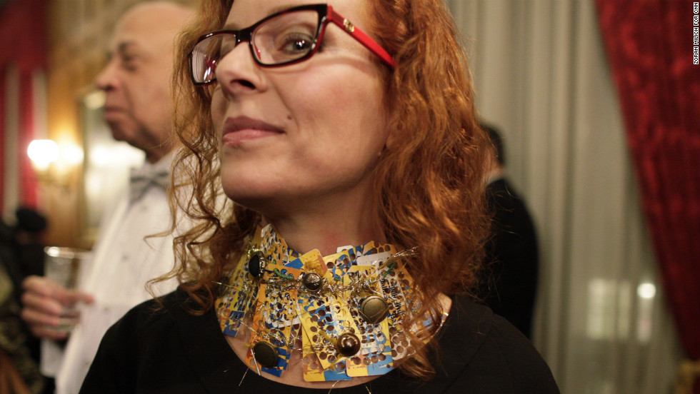 Nina Vishneva, a Russian expatriate, attended the Russian Fashion Industry Showcase and Reception. She wore a necklace made from New York MetroCards.