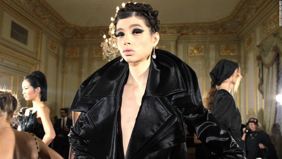 Another model poses in a deep V jacket by Russian designer Bessarion.