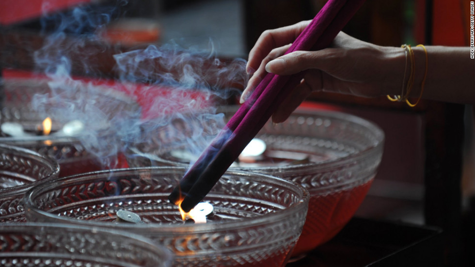 A devotee burns incense sticks as she prays at the Jin De Yuan Buddhist temple, locally known as Vihara Dharma Bhakti, ahead of the Chinese New Year in Jakarta, Indonesia, on February 6.
