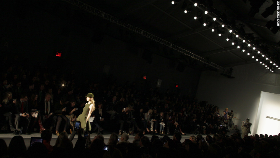 Crowds watch a model walk the runway during Timo Weiland's show on February 7.