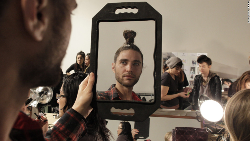 "Billed as the first all-vegan fashion label to present at New York Fashion Week, Vaute Couture held a solo show on Tuesday, February 5. A model checks his hair backstage. <a href=""http://www.cnn.com/2013/02/07/living/nyfw-vegan-vaute-couture/index.html"">View more photos from the event.</a>"