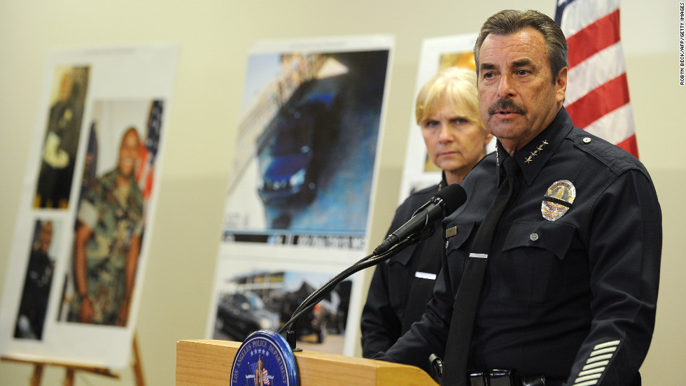 Los Angeles Police Chief Charlie Beck speaks at a press conference about the manhunt for Dorner as photos of the suspect stand in the background on February 7.