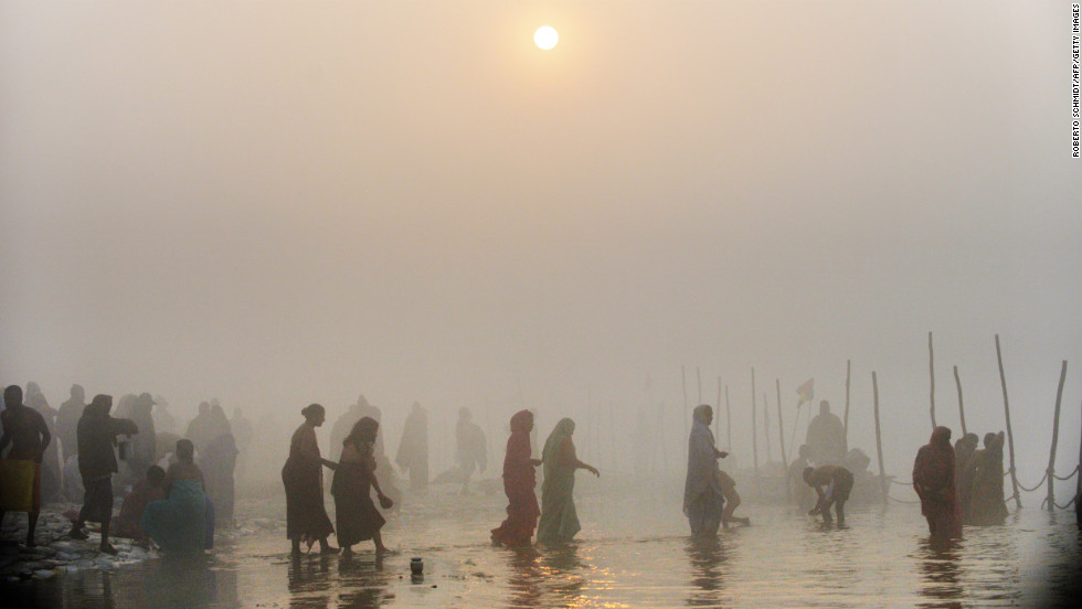 Devotees walk into the waters at the Sangam in Allahabad on January 13.