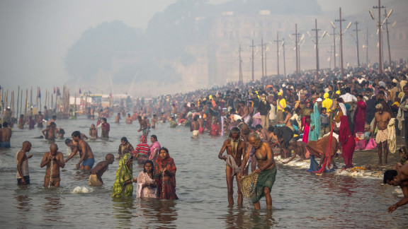 Hindu devotees bathe in the waters of Sangam on January 15.