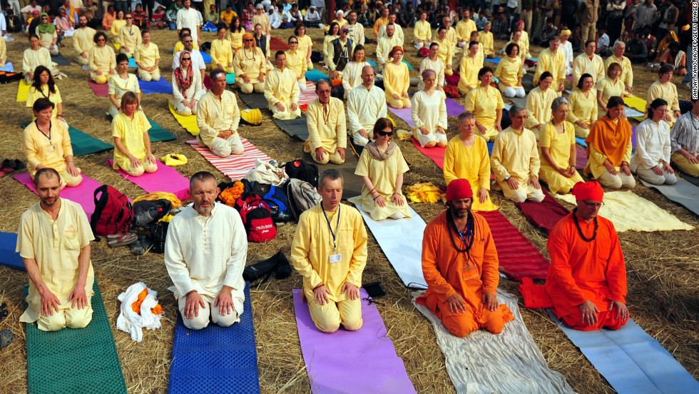 Foreign devotees participate in yoga on the banks of the Sangam on January 16.