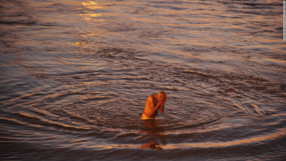 A devotee takes a holy dip at the Sangam, the confluence of the rivers Ganges and Yamuna and the mythic Saraswati on February 7.