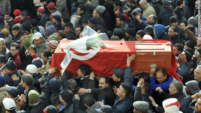Mourners carry the coffin of late opposition leader Chokri Belaid during his funeral procession.  Belaid was buried on Friday.