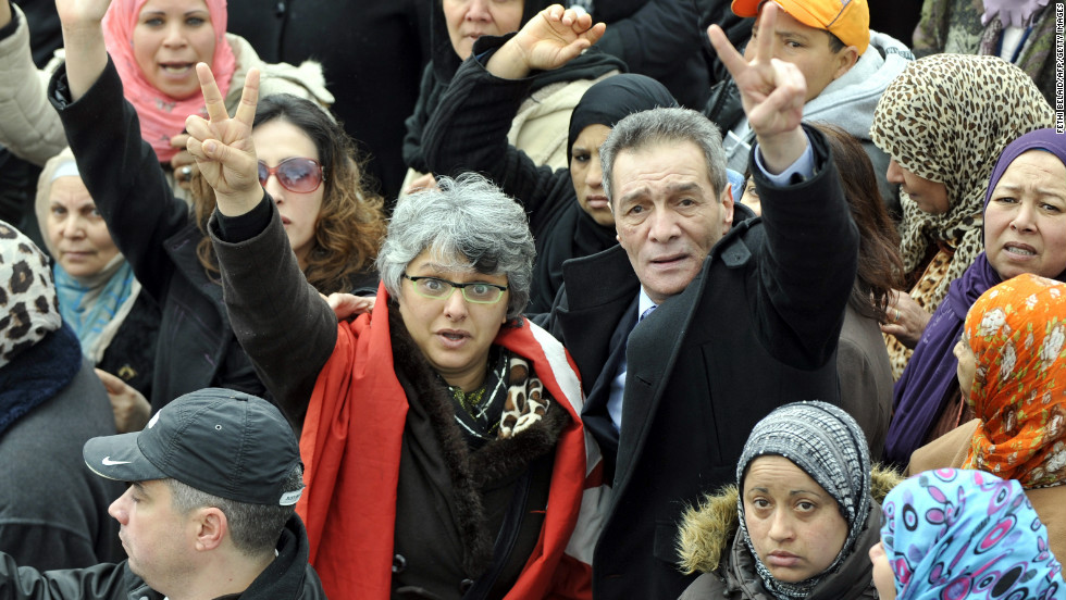The widow Basma Khalfaoui Belaid flashes the victory sign during the funeral procession of her late husband, opposition leader Chokri Belaid, on February 8, 2013 in Tunis.