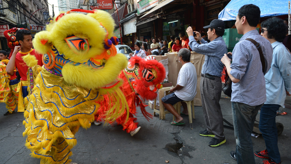 Performers dressed as dragons entertain a Chinatown crowd in Manila, Philippines, on February 8.