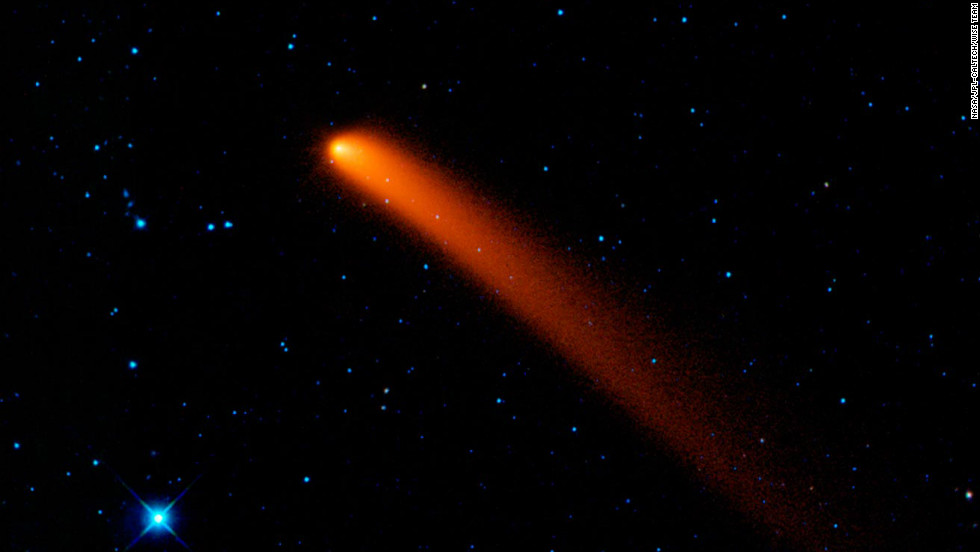 Comet Siding Spring looks like a red blaze in the sky in this infrared image taken on January 10, 2010, from NASA's Wide-field Infrared Survey Explorer (WISE).
