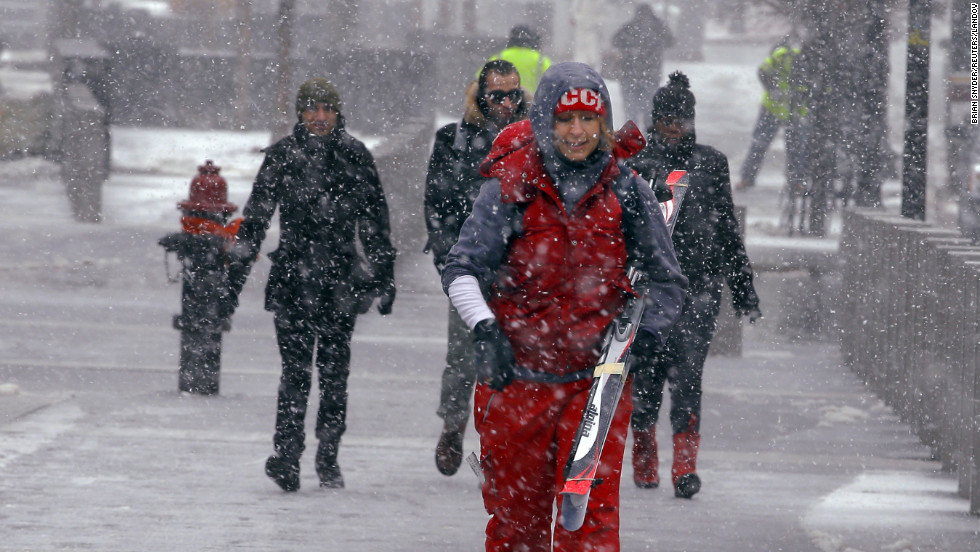 Skiing seems like a good idea as snow begins to fall in Boston on February 8.