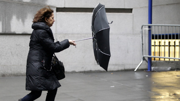 A woman struggles with her umbrella in New York