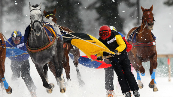 """Competitors race in the Skijoring event. """"We have not got that much control,"""" said six-time champion Franco Moro. """"Around 20% is the driver's responsibility and 80% is the horse."""""""