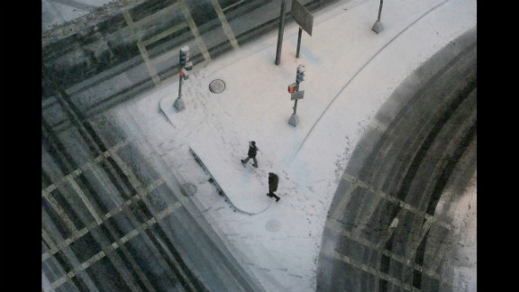 People walk through the snow in Boston