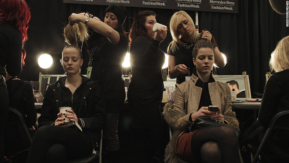 Backstage at the Carmen Marc Valvo show February 8, models get their hair and makeup done.