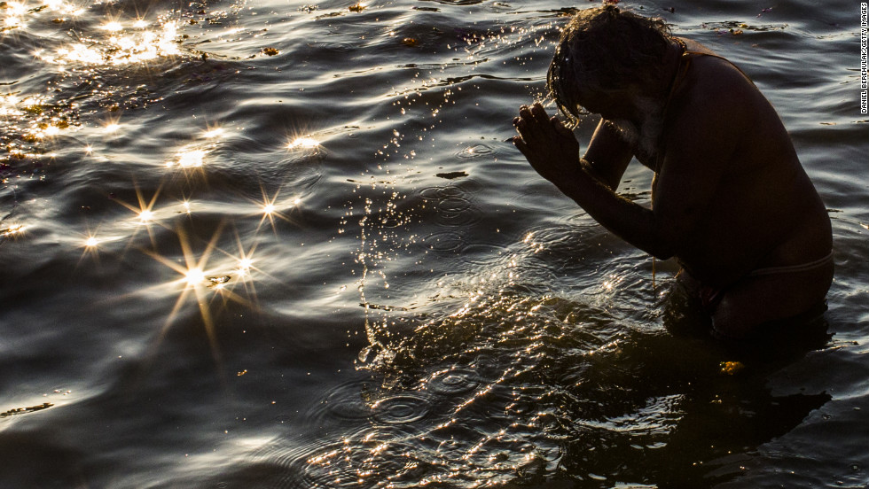 A devotee bathes in the Sangam on February 9.