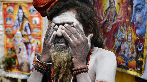 A Sadhu, or holy man, covers his face in ash at the grounds of the Kumbh Mela in Allahabad on February 9.