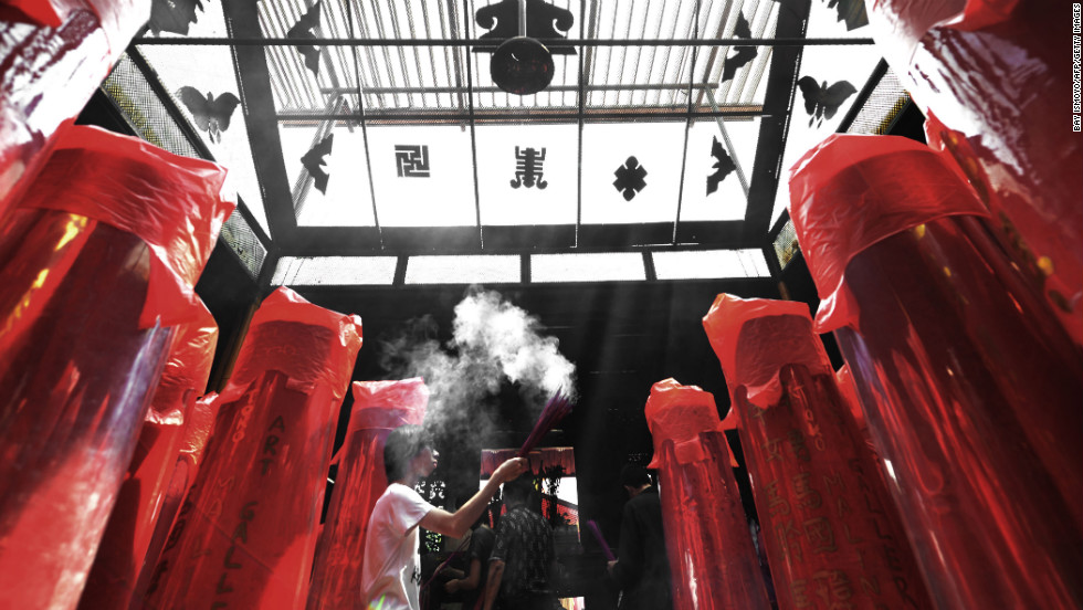 A young man burns incense during a prayer at a Chinese temple in Jakarta, Indonesia, on February 9.