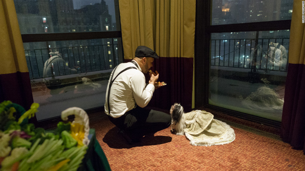 A dog and its owner take a break during the New York Pet Fashion Show.