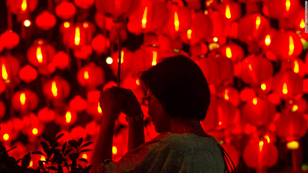 A woman prays at Thean Hou Temple on the eve of the Chinese New Year in Kuala Lumpur, Malaysia.