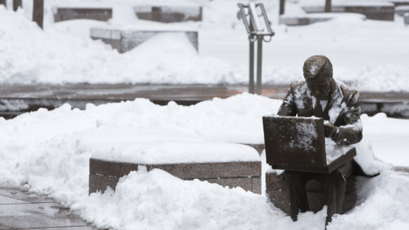 "The sculpture ""Double Check"" by John Seward Johnson II is seen in Zuccotti Park following a major winter storm on Saturday in New York City on Saturday."