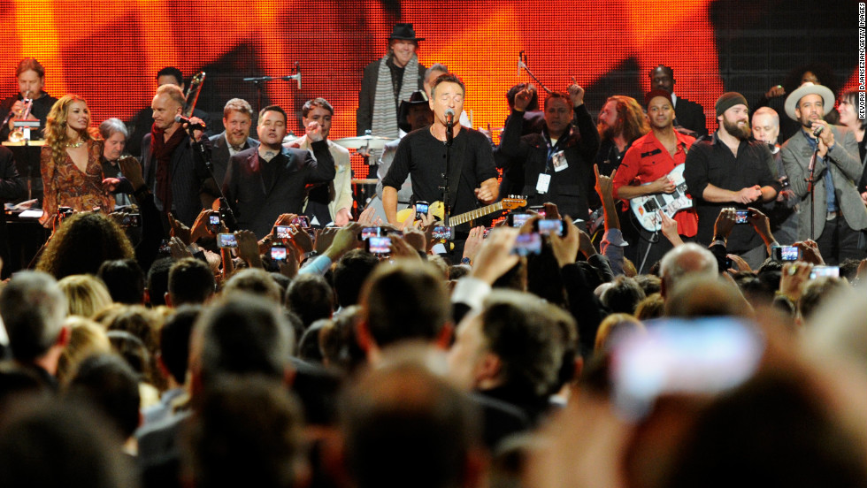 Left to right: Musicians Faith Hill, Garry Tallent, Sting, Ted Dwane, Ken Casey, Ben Lovett, Springsteen,  Jim James, Tom Morello, Zac Brown and Ben Harper perform onstage.