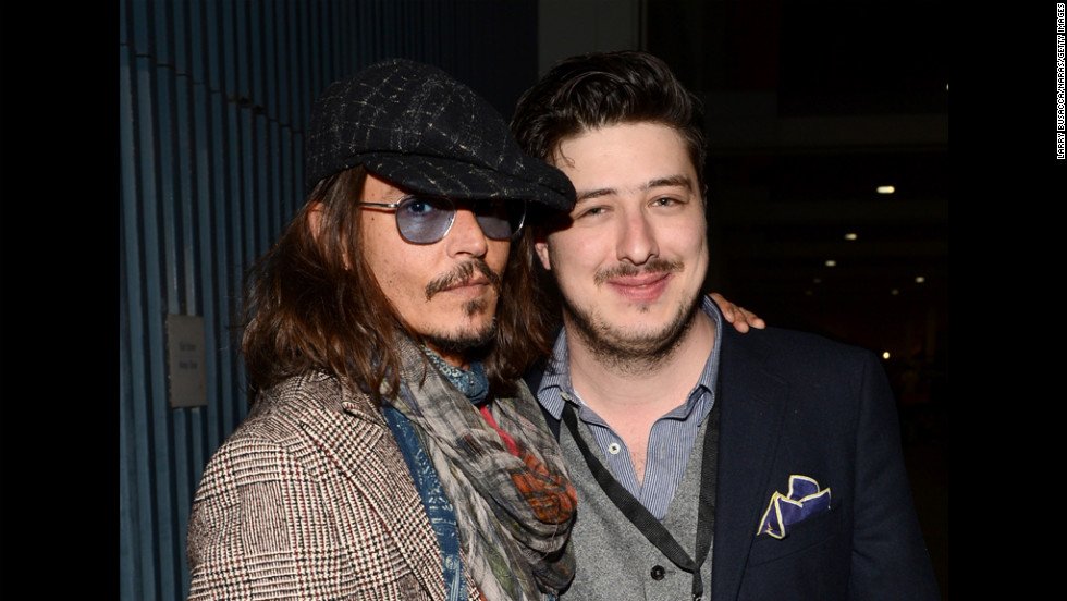 Actor Johnny Depp and Marcus Mumford of Mumford & Sons attend the Musicares gala.