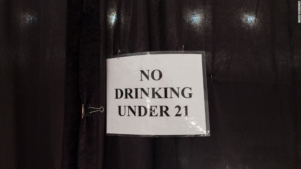 A laminated sign backstage on February 10 reminds models of the drinking age.