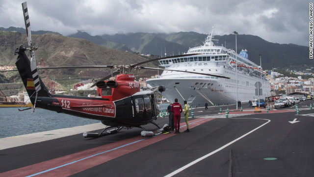 A rescue helicopter arrives at an accident that resulted in the death of five cruise ship crew members in Spain's Canary Islands.