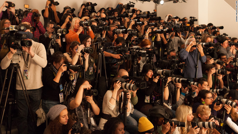 Photographers cram together to shoot the runway on February 10.