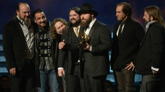 """Members of the Zac Brown Band pick up a Grammy in 2013 for best country album, """"Uncaged."""""""