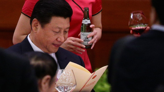 New Chinese leader Xi Xinping (C) has warned the country