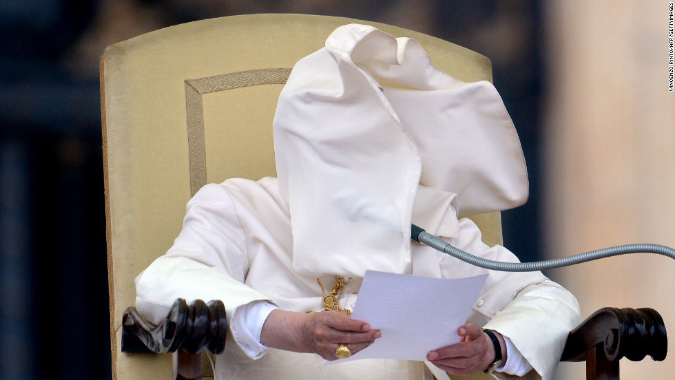 A gust of wind blows Benedict's collar into his face in September 2012 during his weekly address in Saint Peter's Square.