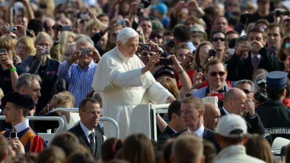Benedict waves to pilgrims as he arrives at St. Peter's Square for his weekly address in October 2012.