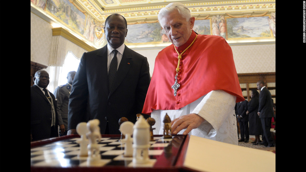 Benedict looks at a chess game with Ivory Coast President Alassane Ouattara during a private audience in November 2012 at the Vatican.